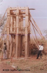 Medical director Dr. T.O. Ojebode (at right) and administrative director Mr. M.A. Olomitutu inspected the construction of the tower while it was under construction