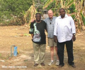 Standing beside the seminary wellhead are Professor Joseph Ilori (left), NFW council member Jon Low and Sabatek's Tunde Adenowo. Sabatek is the company that drilled the well
